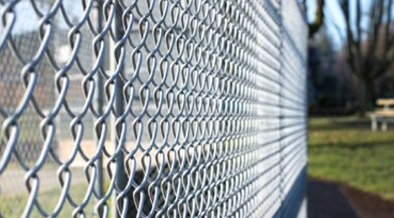 Chain link fences are affordable and very durable. They are great for security and come in many different colors. They can also be made into privacy fences using vinyl slats that are inserted between the links.
