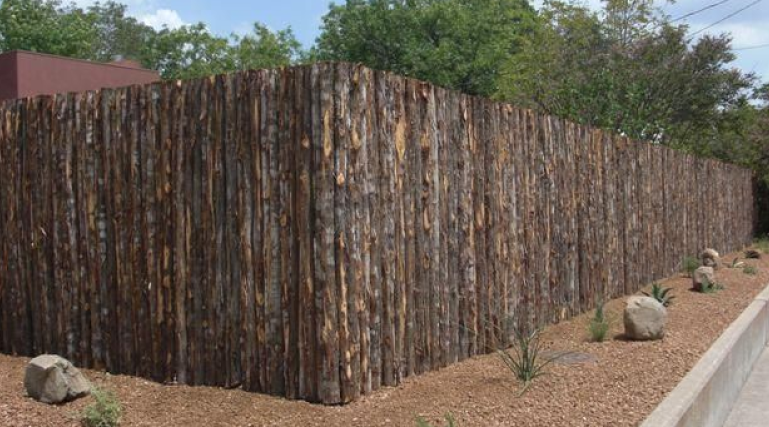 A very popular type of fence in the area and very distinct to Santa Fe New Mexico is the Coyote fence or Santa Fe style fence. Coyote fences are made out of Spruce-Fir latillas that are tied to a steel welded framework.